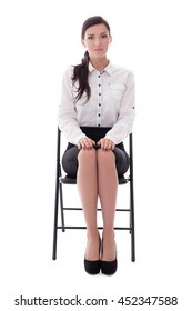 young woman sitting on office chair isolated on white background