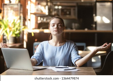 Young woman sitting in public place take break distracted from work or study do yoga exercise meditation practice. No stress negative emotions relieve, good healthy life habit internal balance concept
