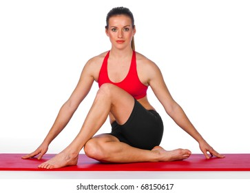 young woman sitting in relaxing yoga pose