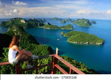 Young woman sitting at the view point, Wua Talab island, Ang Thong National Marine Park, Thailand