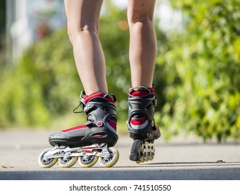 young woman skating with inline skates