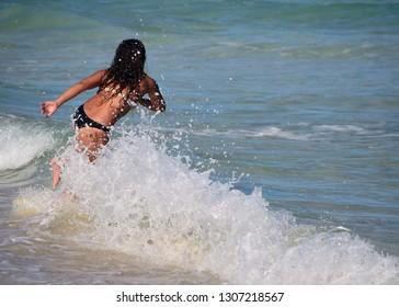 Young woman skim boarder