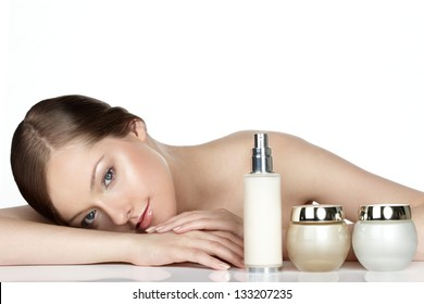 young woman and skincare products on white. Space for text.