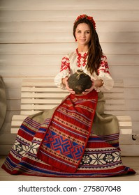 young woman in a Slavic Belarusian national original suit studio