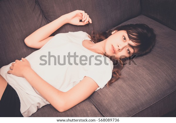 young woman sleep at home and she lying on the sofa at home. concept for healthy care