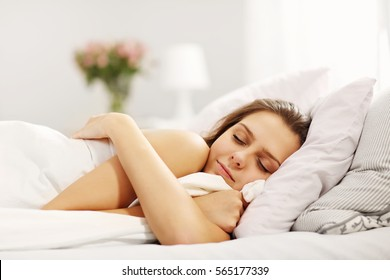 Young woman sleeping in bed