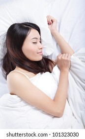 Young Woman sleeping on the bed in the morning at home , model is a asian beauty