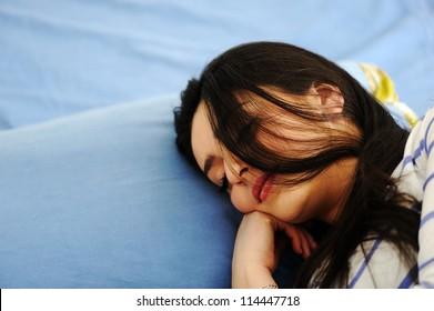 [Image: young-woman-sleeping-on-bed-260nw-114447718.jpg]