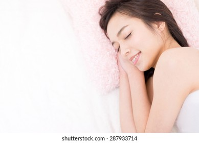 young woman sleeping on a bed