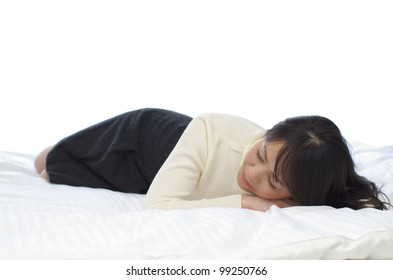 Young woman sleeping on the bed