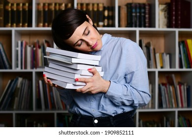 Young woman sleeping on the books in the library