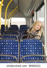 Young woman sleeping on the bus