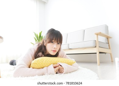 Young woman sleeping in room