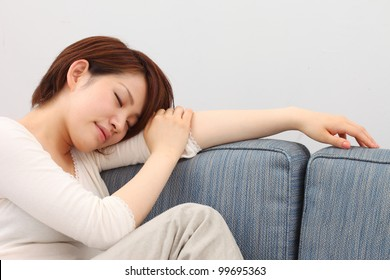 young woman sleeps on a bed in a bedroom at home