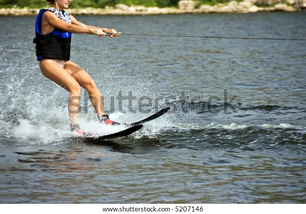 Young woman sliding on the water ski