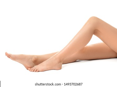 Young woman with slim legs on white background