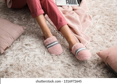 Young woman in slippers at home