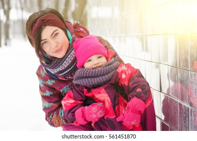 Young woman with small daughter