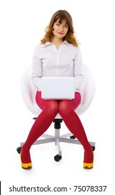 A young woman with a small laptop sitting in a chair isolated on white background