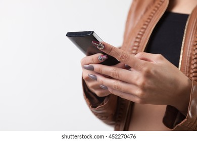 Young woman with smartphone in studio