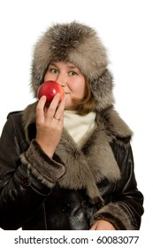young woman is smelling apple over white