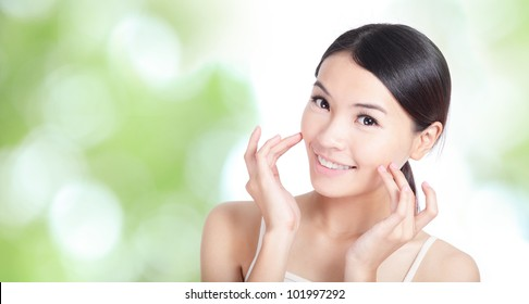 Young woman smile and hand touch face concept for health body care with green nature background, model is a asian beauty