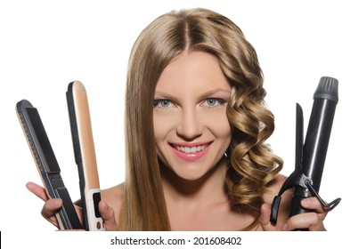 Young woman with  smile holds curling iron