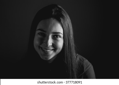 Young woman smile. Studio. Black and white. High contrast