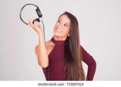 young woman smiles at the headphones