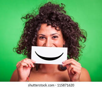 Young Woman with Smiley Emoticon on Green Background