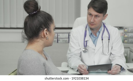 Young woman smiling to the camera during medical appointment at clinic