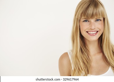 Young woman smiling at camera, portrait