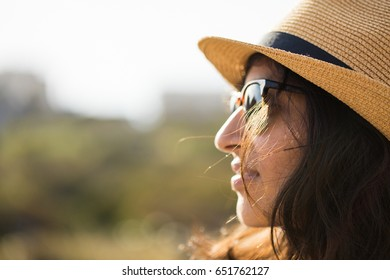 young woman smiling in the countryside