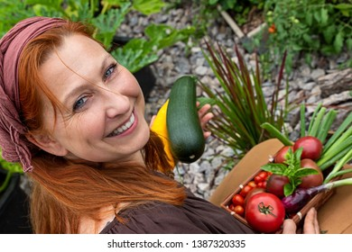 Young woman is smiling happily about her harvest