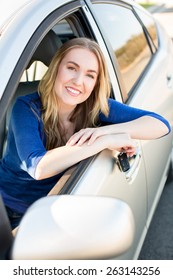 Young woman smiling in her car