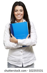 young woman smiling and holding a notebook against a white background