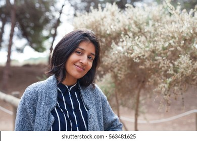 young woman smiling in the park