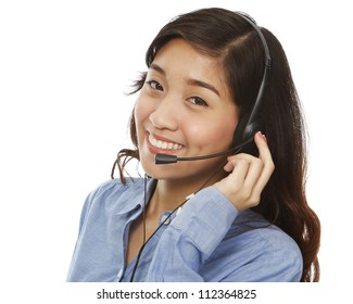 A young woman smiling and wearing a headset (isolated on white)