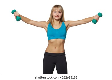 Young woman smiling while using dumbbells against a white background