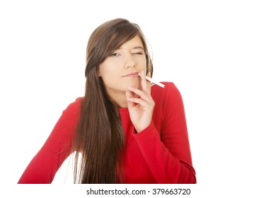 Young woman smoking cigarette.