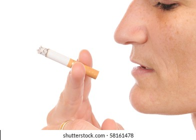 A young woman is smoking a cigarette
