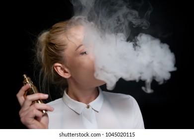 Young woman smoking vaporizer