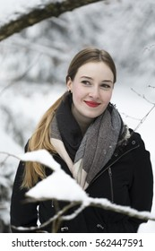 young woman snow walk beauty portrait fun smile candid