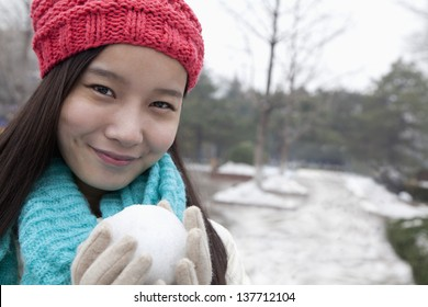 Young Woman with Snowball