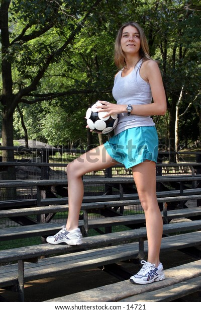 young woman with soccer ball