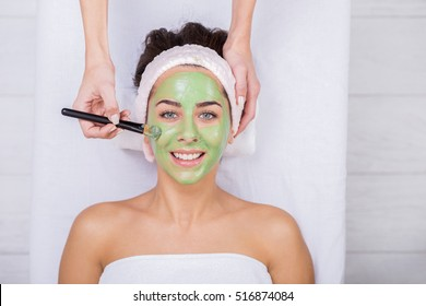 Young woman in a spa with algae facial mask. Woman in spa salon