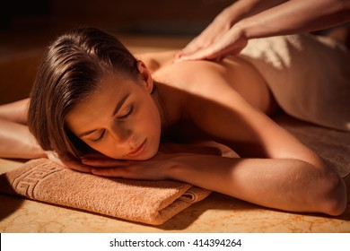 Young woman at spa massage