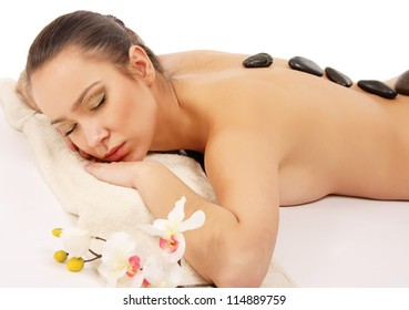 Young woman at spa procedure Isolated on white background