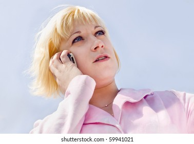 The young woman speaks on the phone