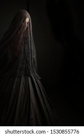 Young woman in spooky concept images with Victorian feel